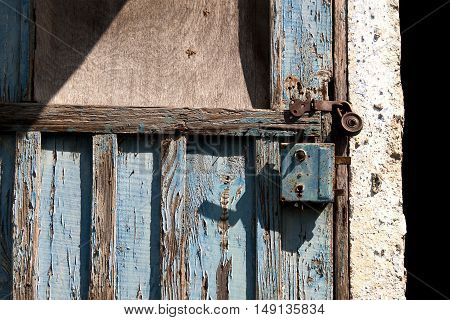 Old padlock on a wooden door texture