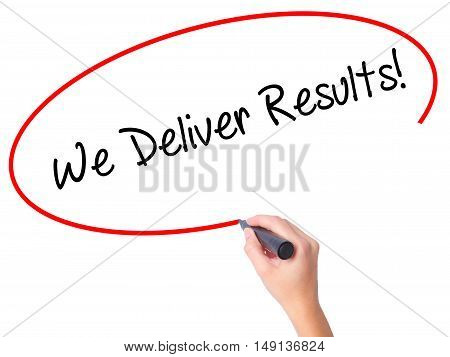 Women Hand Writing We Deliver Results! With Black Marker On Visual Screen