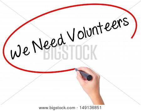 Women Hand Writing We Need Volunteers With Black Marker On Visual Screen