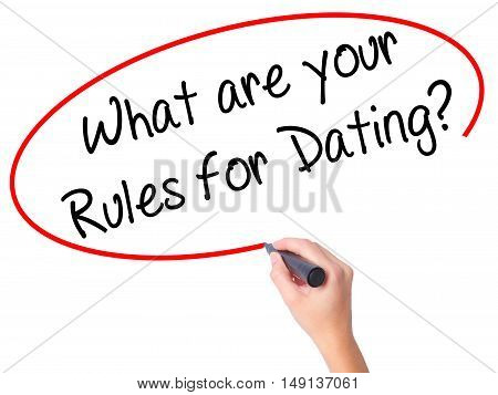 Women Hand Writing What Are Your Rules For Dating?  With Black Marker On Visual Screen