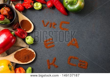 Concept of the health properties of peppers. inscriptions on stone countertop has been made with paprika powder