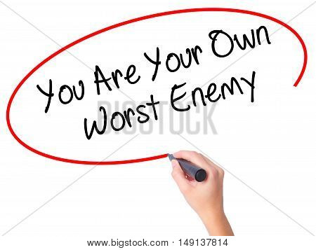 Women Hand Writing You Are Your Own Worst Enemy With Black Marker On Visual Screen