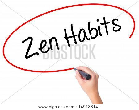 Women Hand Writing Zen Habits With Black Marker On Visual Screen