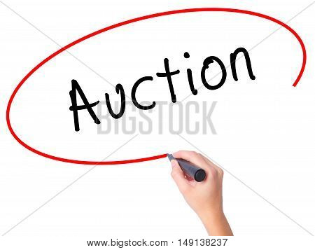 Women Hand Writing Auction With Black Marker On Visual Screen