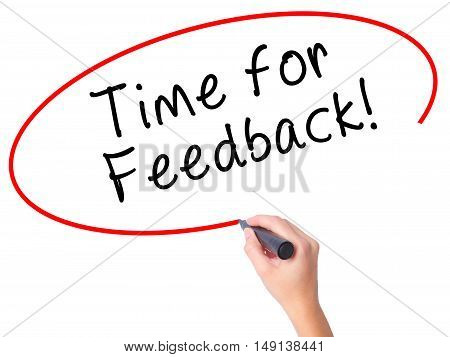 Women Hand Writing Time For Feedback With Black Marker On Visual Screen