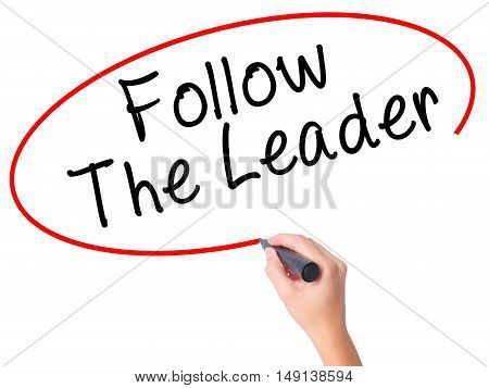 Women Hand Writing Follow The Leader With Black Marker On Visual Screen