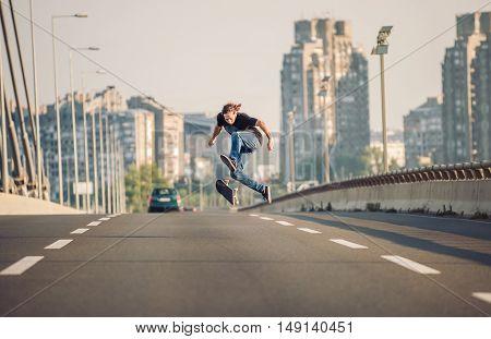 Skater Doing Tricks And Jumping On The Street Highway Bridge. Free Riding Skateboard