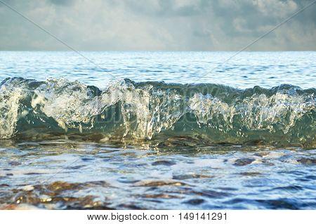 Ocean strong waves crash over the beach.
