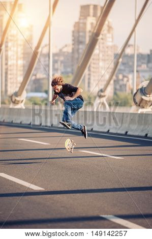 Skater Doing Tricks And Jumping On The Street Highway Bridge. Free Riding Skateboard