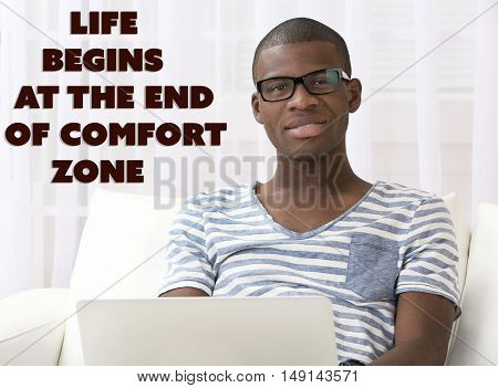 Comfort zone concept. Handsome African American man sitting with laptop