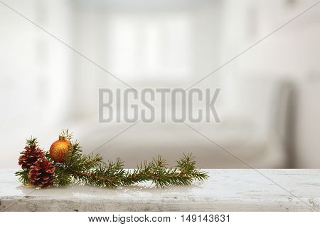christmas decoration on old white wooden table in the living room with big window