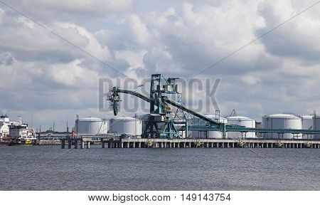 Petrochemical complex with cargo crane in a marine port. Ventspils Latvia