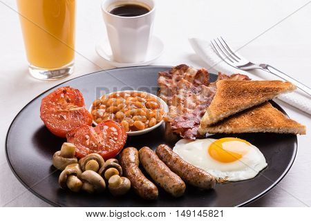Full English Breakfast On Black Plate