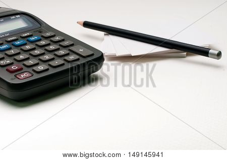 pencil on paper note, calculator, white background