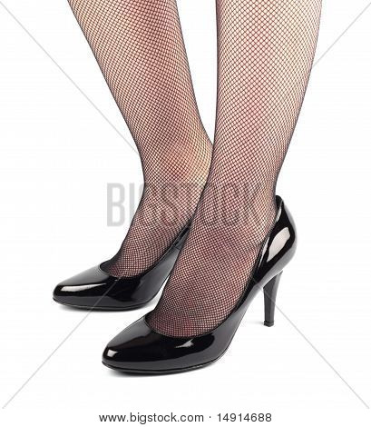 Girl Legs In Black Patent Leather  High Heeled Shoes
