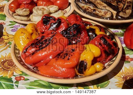 Paprika grilled and laid on a ceramic plate with natural sunlight