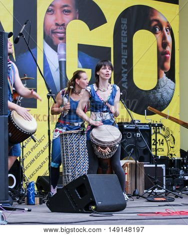 St. Petersburg, Russia - 13 August, Playing the drum,13 August, 2016. Africa and the Russian Culture Festival on Krestovsky Island in St. Petersburg.