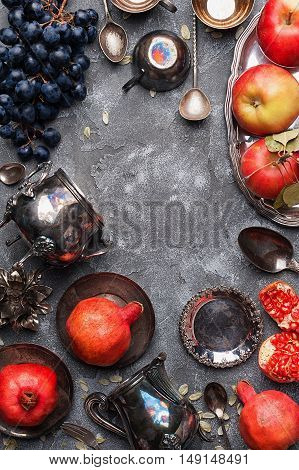 Autumn fruits on gray textural background top view with copy space