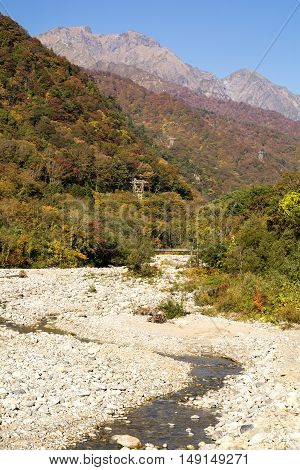 Autumn Yubiso river and Mount Tanigawa under blue sky