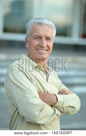 portrait of happy Senior man  in town