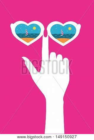 female hand with glasses glasses which reflect the beach