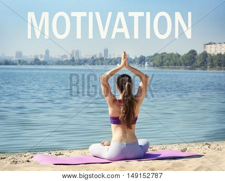 Word MOTIVATION on background. Business trainer concept. Young woman in yoga pose on mat.