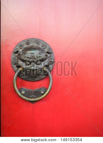 The Lion bell with red gates doors
