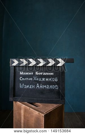 vintage photo of movie clapper on wood