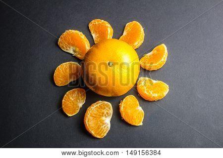 Orange Mandarin Or Tangerine Fruit On Black Background