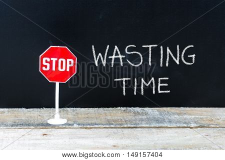 Stop Wasting Time Message Written On Chalkboard