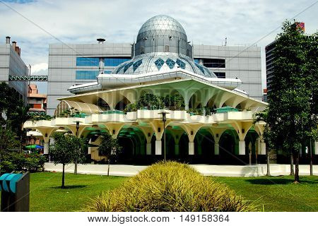 Kuala Lumpur Malaysia - January 1, 2008: Modernist Islamic Masjid Asy-Syakirin Mosque in the park at Suria KLCC with its rounded silver dome