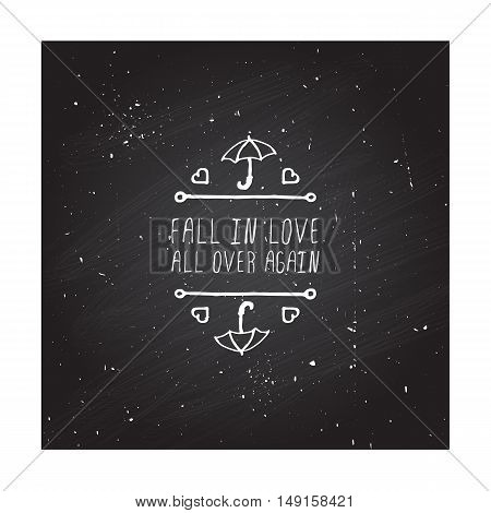 Hand-sketched typographic element with umbrella, hearts and text on chalkboard background. Fall in love all over again