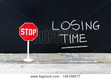 Stop Losing Time Message Written On Chalkboard