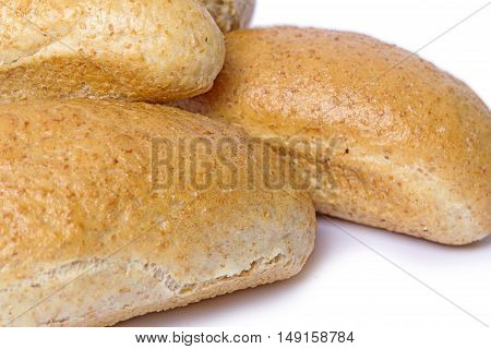 Wheat bread with bran on a light background. Isolation