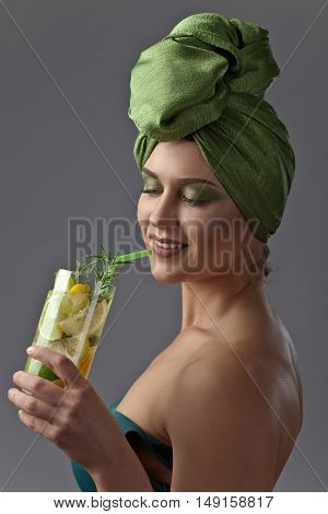 Woman In A Green Turban With A Cocktail