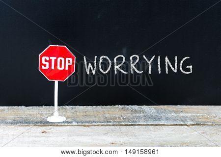 Stop Worrying Message Written On Chalkboard