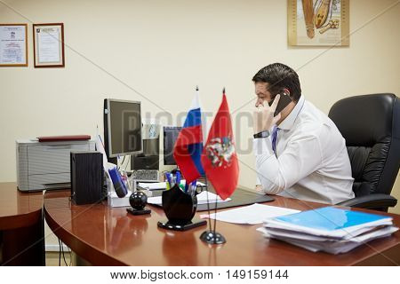 MOSCOW, RUSSIA - JAN 26, 2015: Maxim Koval Head of district council Bogorodskoe talks phone. Total area of Bogorodskoe - 1024 hectares.