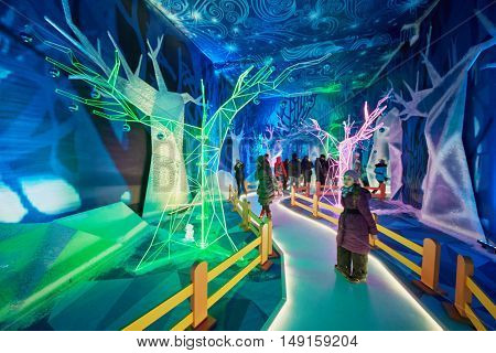 MOSCOW, RUSSIA - DEC 20, 2014: Visitors in the Father Frost House in the pavillion at VDNKH exhibition during celebrating New Year holidays.