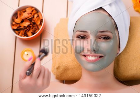 Young woman relaxing in spa in health concept