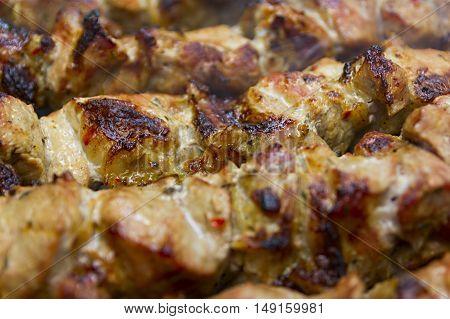 Grilled Marinated Caucasus Barbecue Meat Shashlik (Shish Kebab) Pork Meat Grilling On Metal Skewer Close Up