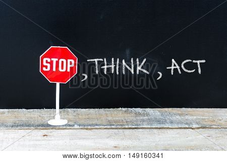 Stop, Think, Act Message Written On Chalkboard