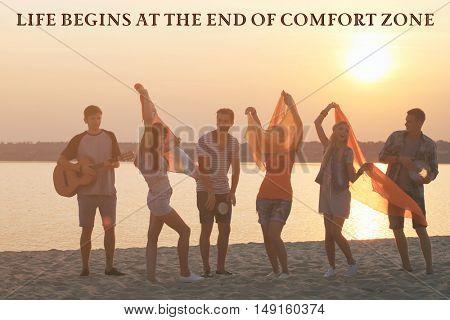 Comfort zone concept. Joyful friends having fun on the shore at sunset outdoors