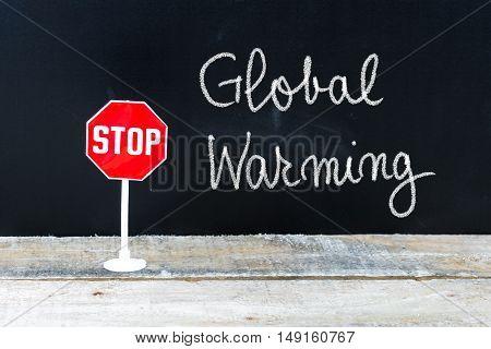 Stop Global Warming Message Written On Chalkboard