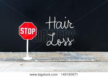 Stop Hair Loss Message Written On Chalkboard