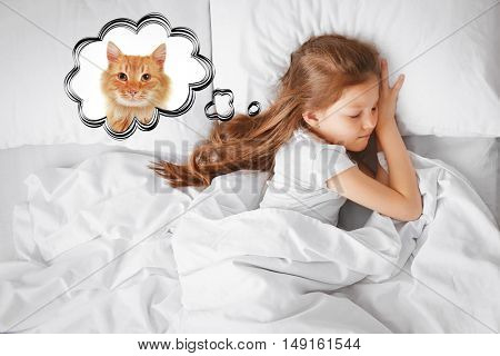 Cute girl in white bed dreaming about the cat