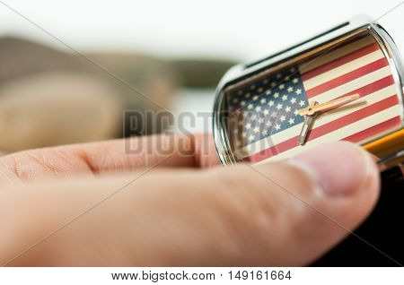 hand hold a watch America flag in background watch, focus on America flag in background watch, fashion watch 4th July, God Bless America, America flag