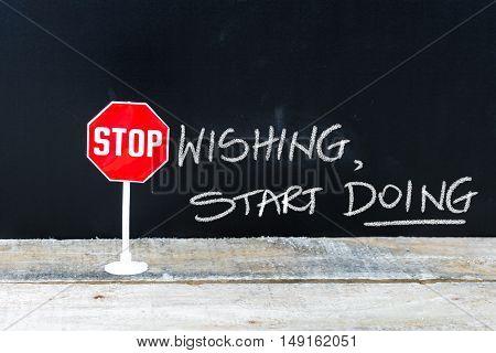 Stop Wishing Start Doing Message Written On Chalkboard