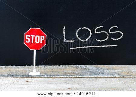Stop Loss Message Written On Chalkboard