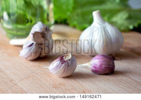Closeup fresh garlic on kitchen table. Natural medicinal ingredient