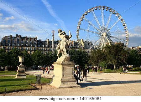 FRANCE. PARIS - JUNE 24, 2015: Ferris wheel in the Tuileries Gardens. The Tuileries Garden is one of the most popular vacation spots of the townspeople and tourists.
